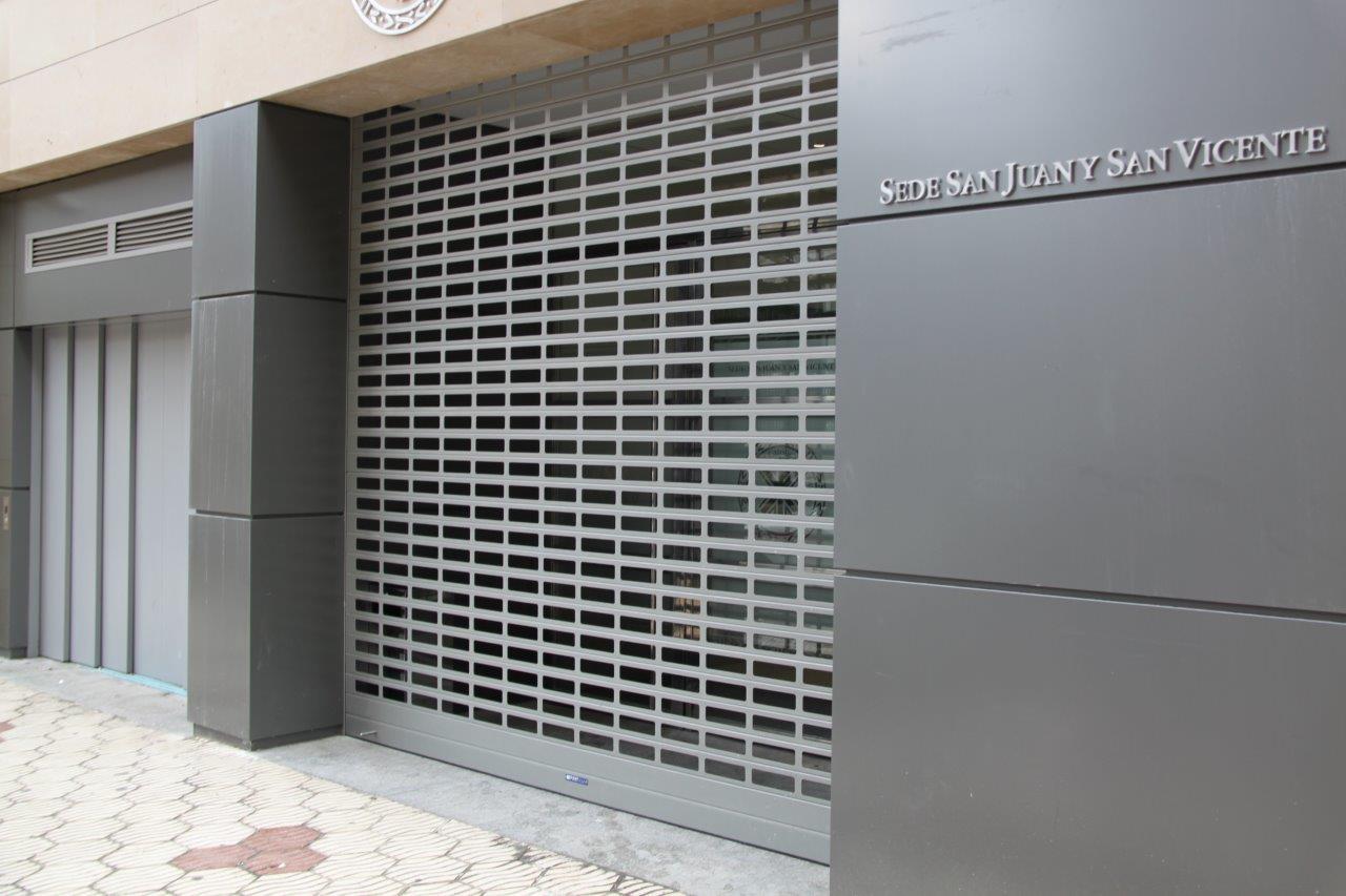 Puertas enrollables cristaler a online barata for Puerta enrollable